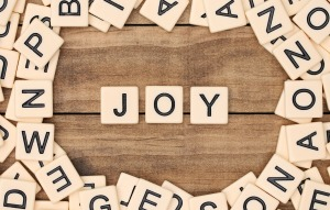 Joy spelled out in tan tile letters