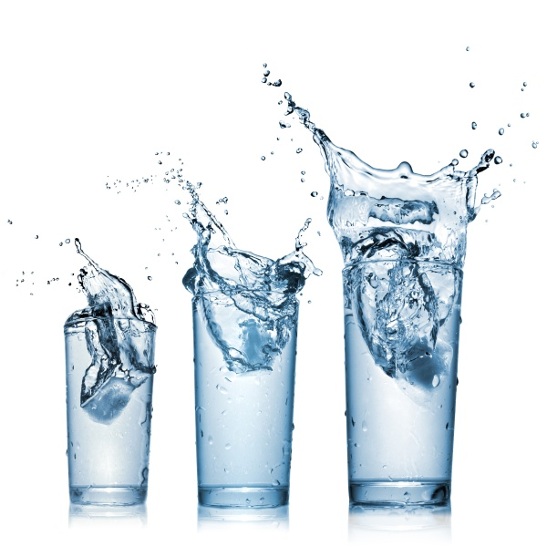 water splash in glasses isolated on white